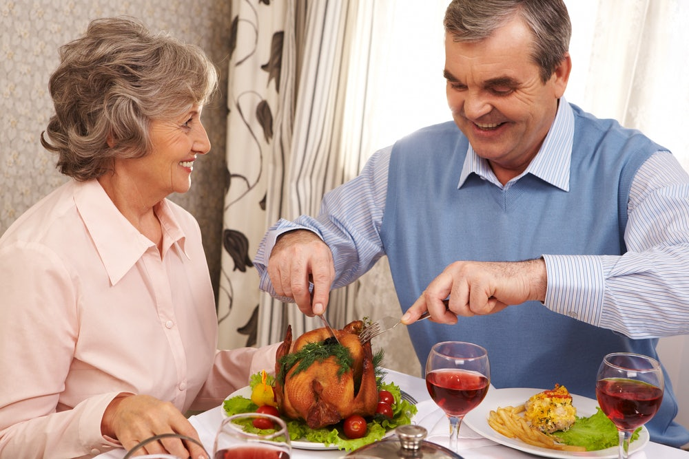 Happy-couple-sharing-a-small-roast-turkey-at-our-luxury-condos-in-Gatlinburg-TN.jpg