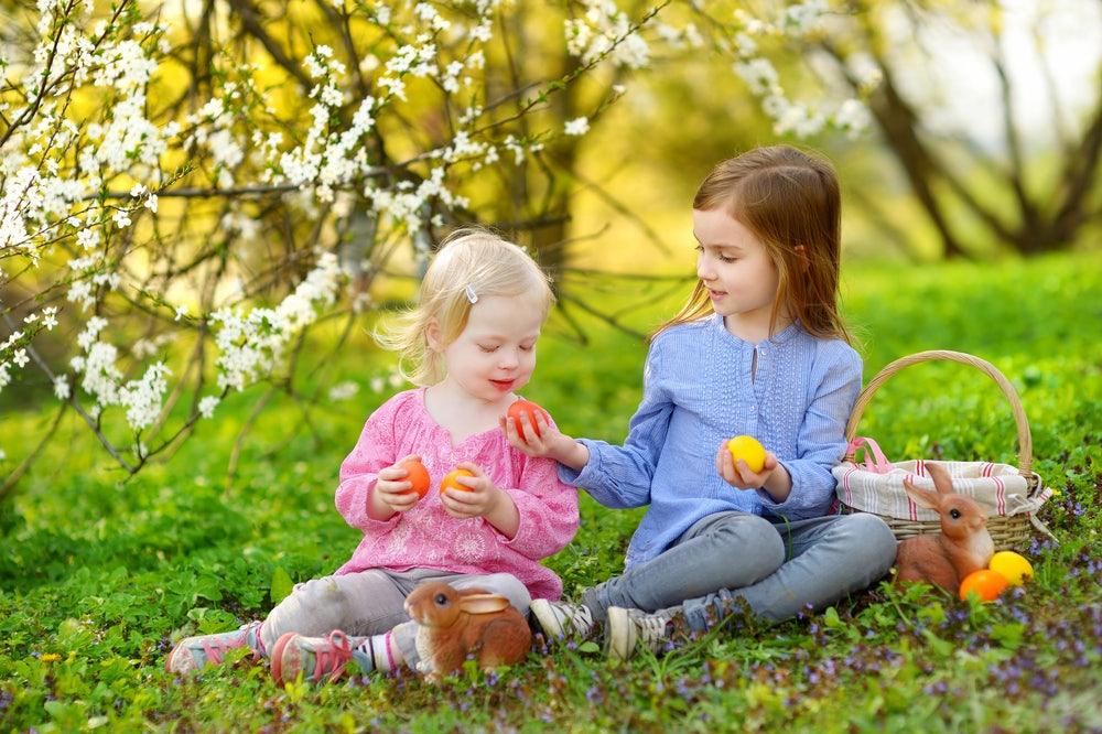 Sisters-sharing-Easter-eggs-near-their-condo-rental-in-Gatlinburg.jpg
