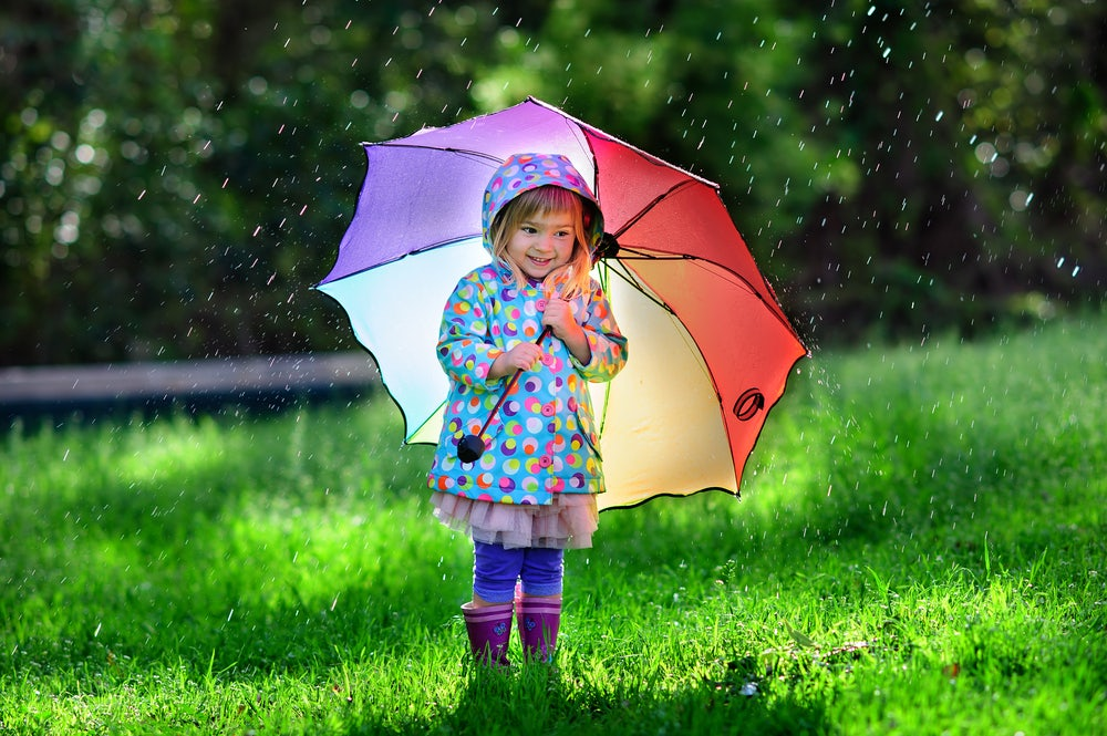 Toddler-with-umbrella-in-the-rain.jpg
