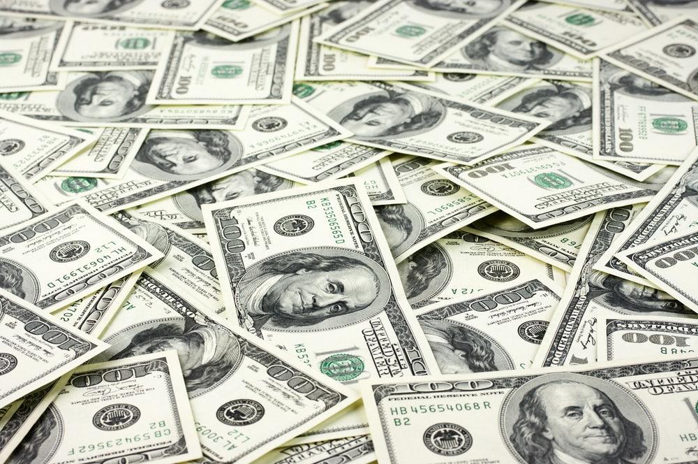 A-big-pile-of-hundred-dollar-bills-saved-on-an-affordable-Gatlinburg-condo-vacation.jpg